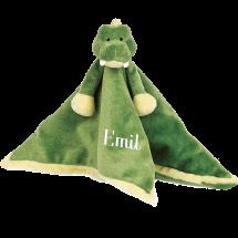 En mjuk och tröstande filt med ett mysig krokodil för de allra minsta.